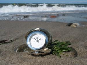 Clock on beach