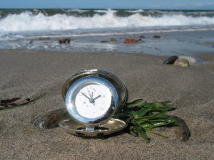 Clock on beach
