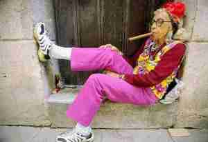 old lady smoking cigar