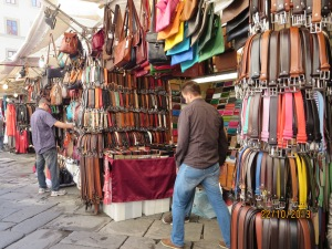 Rows of vendors selling leather goods